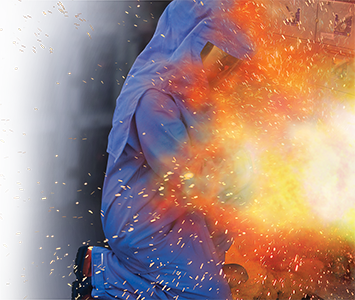 image of arc flash explosion - man with arc rated suit